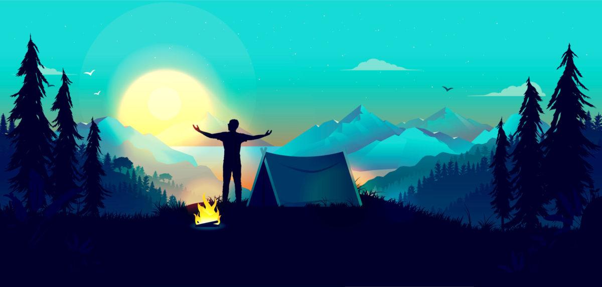 山の上で早朝に深呼吸をする男の写真