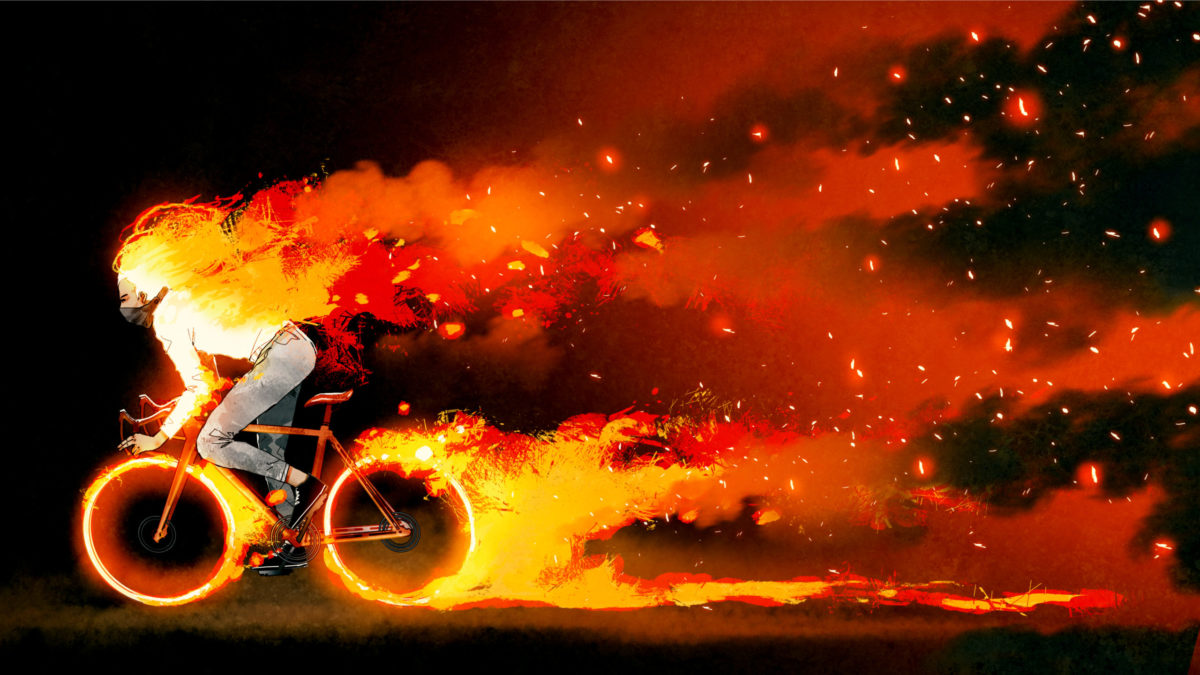 火花が出るほど猛スピードで自転車を漕ぐ男性の写真