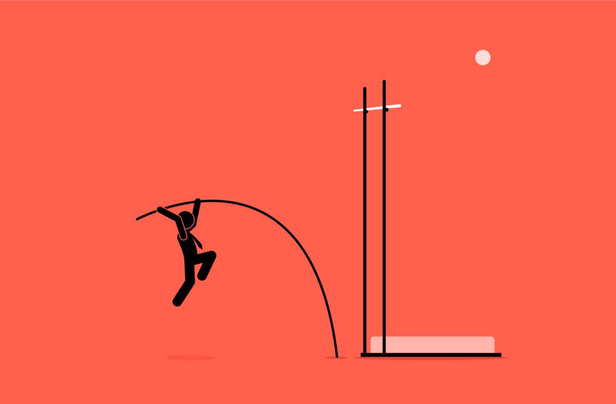 棒高跳びをしようとしている男の写真