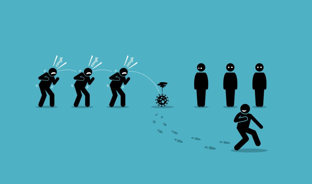集団の中から、コロナウイルスから逃げる男の画像