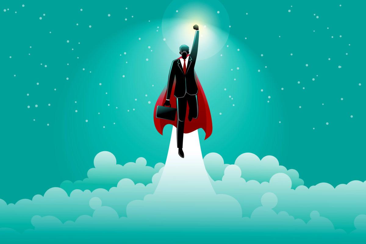 ビジネスマンが雲を突破するほど飛躍する写真